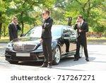 handsome bodyguards near car... | Shutterstock . vector #717267271