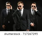 handsome bodyguards on dark... | Shutterstock . vector #717267295