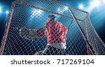 ice hockey goalie saves a goal... | Shutterstock . vector #717269104