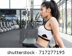 young woman in sportswear doing ... | Shutterstock . vector #717277195