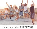 group of young people having... | Shutterstock . vector #717277609