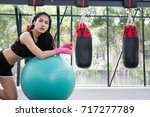 young woman execute exercise in ... | Shutterstock . vector #717277789