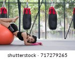young woman execute exercise in ... | Shutterstock . vector #717279265