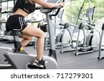 young woman execute exercise in ... | Shutterstock . vector #717279301