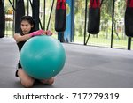 young woman execute exercise in ... | Shutterstock . vector #717279319