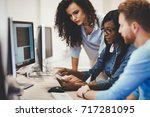 programmer working in a... | Shutterstock . vector #717281095
