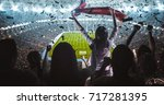 group of fans are cheering for... | Shutterstock . vector #717281395