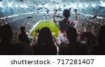 group of fans are cheering for... | Shutterstock . vector #717281407