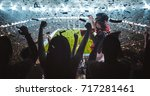 group of fans are cheering for... | Shutterstock . vector #717281461