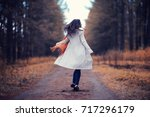 young woman in a trench coat...   Shutterstock . vector #717296179