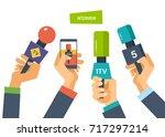 hands hold microphones ... | Shutterstock .eps vector #717297214
