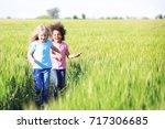 Happy Little Girls Green Field - Fine Art prints