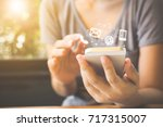 woman hand using smart phone ... | Shutterstock . vector #717315007