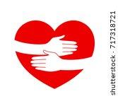 hug hand in heart shape. love... | Shutterstock .eps vector #717318721