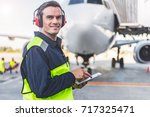 happy mechanic having job in... | Shutterstock . vector #717325471