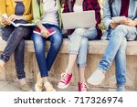 young students on campus | Shutterstock . vector #717326974