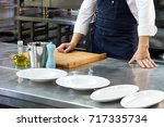 the cook stands near the... | Shutterstock . vector #717335734