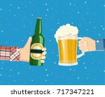 beer party. hands holding beer... | Shutterstock .eps vector #717347221