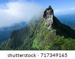 lush green peak of mountain... | Shutterstock . vector #717349165