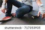 unrecognizable skater ready to... | Shutterstock . vector #717353935