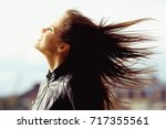 wind hair hairstyle hair... | Shutterstock . vector #717355561