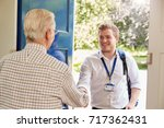 senior man greeting male care... | Shutterstock . vector #717362431