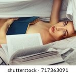 young redhead naked girl in bed ... | Shutterstock . vector #717363091