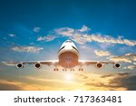 airplane take off on the blue... | Shutterstock . vector #717363481