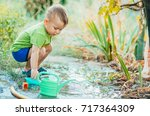 little boy with mom in the... | Shutterstock . vector #717364309