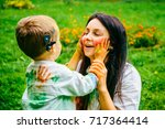 happy mother and son playing... | Shutterstock . vector #717364414