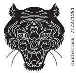 tiger head silhouette vector... | Shutterstock .eps vector #717371281