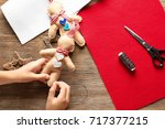 little child sewing christmas... | Shutterstock . vector #717377215