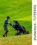 golfers at the golf course. | Shutterstock . vector #717393331