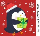 cute penguin bring gift | Shutterstock .eps vector #717413089