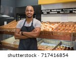smiling baker man standing with ... | Shutterstock . vector #717416854