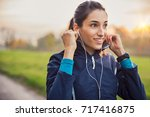 young athlete adjusting jacket... | Shutterstock . vector #717416875