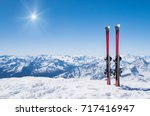pair of skis in snow with copy... | Shutterstock . vector #717416947