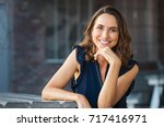 portrait of beautiful mature... | Shutterstock . vector #717416971
