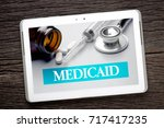 medicaid word with stethoscope  ... | Shutterstock . vector #717417235