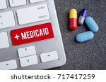 word medicaid on keyboard with... | Shutterstock . vector #717417259