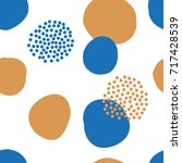 abstract pattern with circles... | Shutterstock .eps vector #717428539