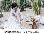 woman decorator designer or...   Shutterstock . vector #717429361