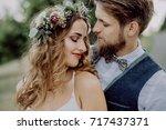 beautiful bride and groom in... | Shutterstock . vector #717437371