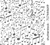 seamless pattern with music... | Shutterstock .eps vector #717444649
