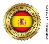 made in spain golden badge with ... | Shutterstock .eps vector #717465541