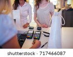 photo of saleswoman pulling out ... | Shutterstock . vector #717466087