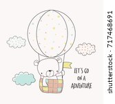 little bear in a hot air... | Shutterstock .eps vector #717468691