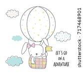 little bunny in a hot air... | Shutterstock .eps vector #717468901
