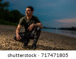 handsome man in military style... | Shutterstock . vector #717471805