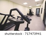 gym equipped with weights and... | Shutterstock . vector #717473941